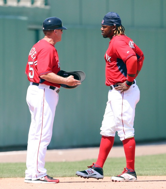 Boston Red Sox third base coach Brian Butterfield, left, talks with Red Sox base runner Hanley Ramirez after the fourth inning of a Grapefruit League spring training game against the Baltimore Orioles in Fort Myers, Fla. on Friday, March 20, 2015.